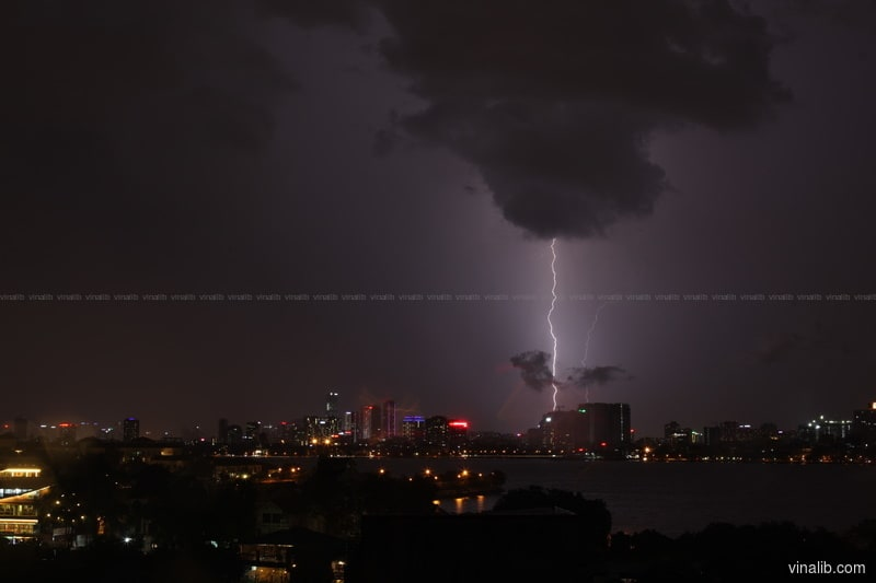 A lightning strike in West Lake, Hanoi - Vinalib Stock Pictures