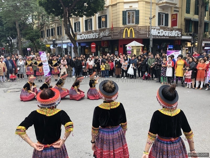 H'Mong style zumba dance promotion in front of a McDonalds in Hanoi, Vietnam - Vinalib Stock Pictures