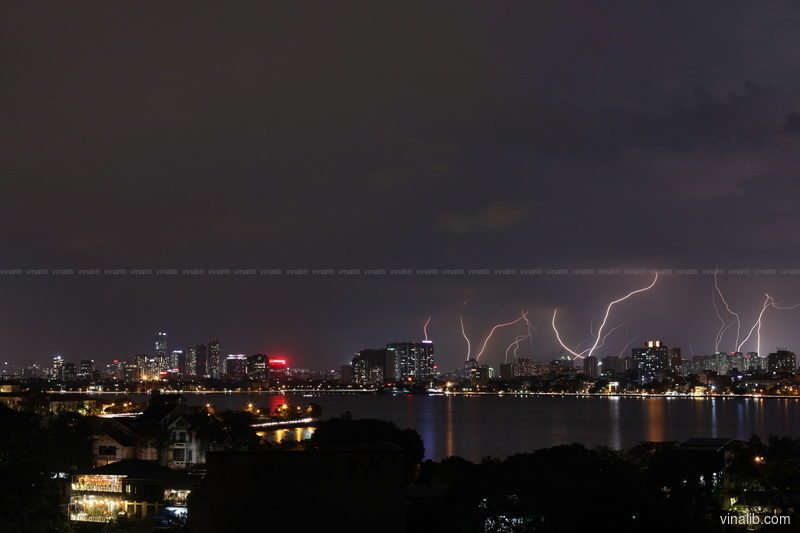 Multiple lightning strikes over West Hanoi suburbs - Vinalib Stock Pictures