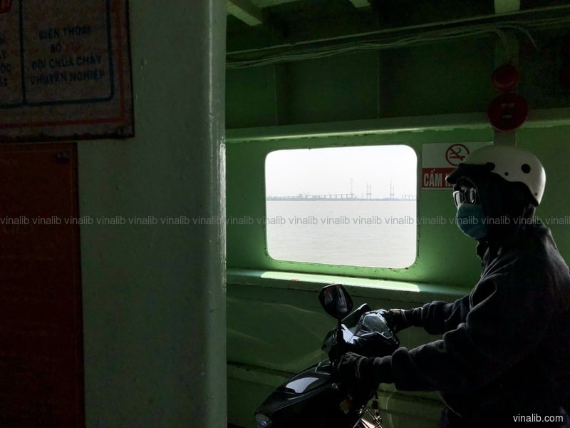 13:52 Ninja, on a ferry crossing the Nha Be river - Vinalib Stock Pictures