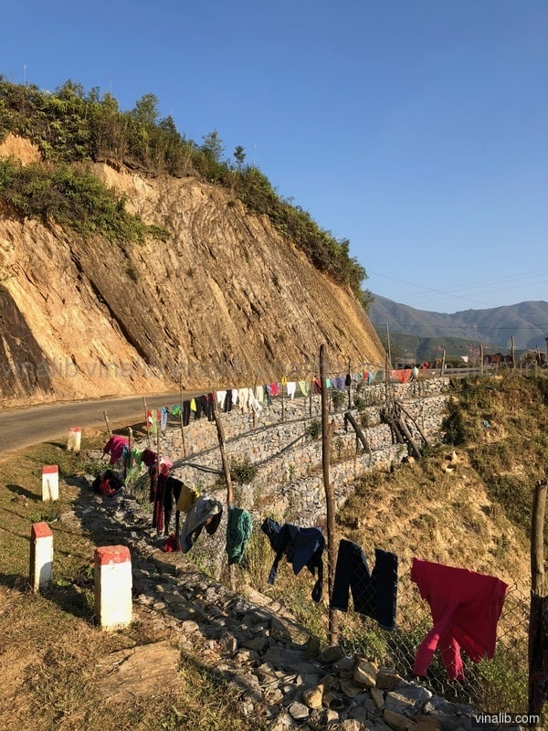 Colorful clothes drying on the side of the road - Vinalib Stock Pictures